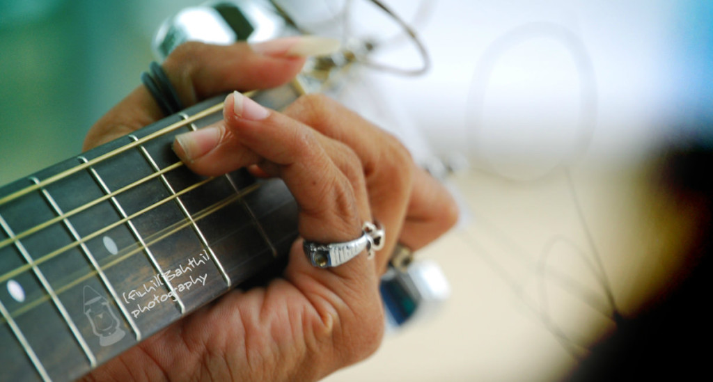 guitar strings and hand